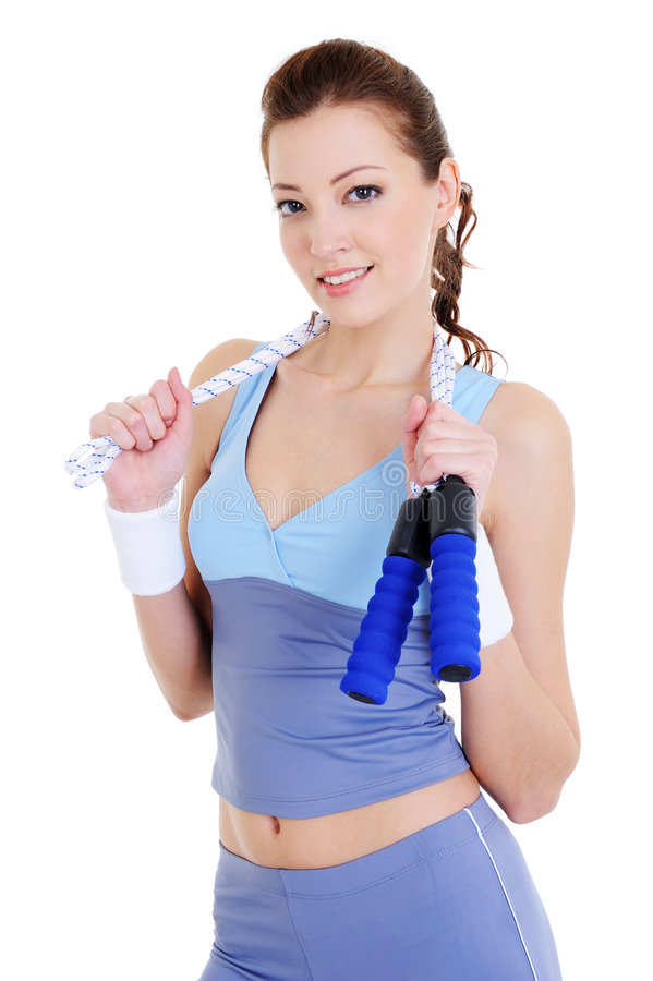 Woman training with jump rope. Beautiful young woman training with jump rope - isolated royalty free stock photo