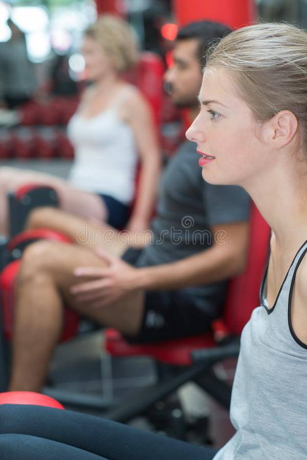 Woman training legs in gym. Woman royalty free stock image