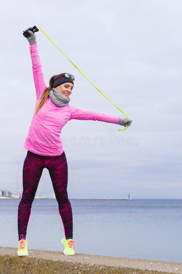 Download Woman Training Outdoor With Jump Rope On Cold Day Stock Photo - Image: 83711502