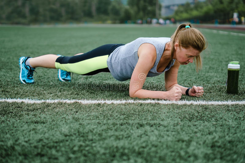 Woman training at the stadium. Physical activity and endurance. royalty free stock image