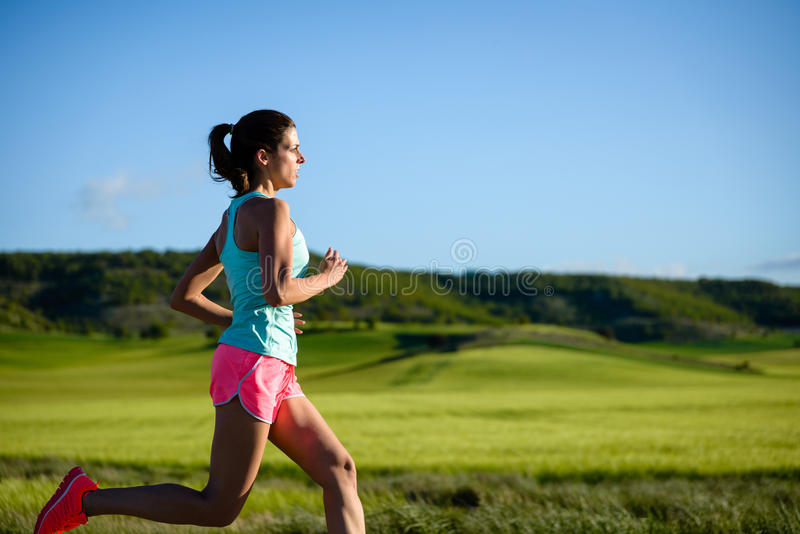 Woman training trail cross running royalty free stock images