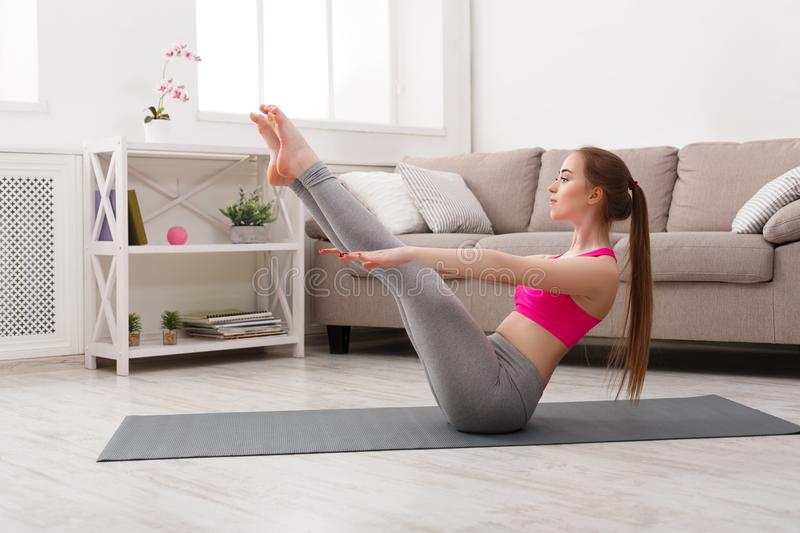 Woman training yoga in boat pose. stock image