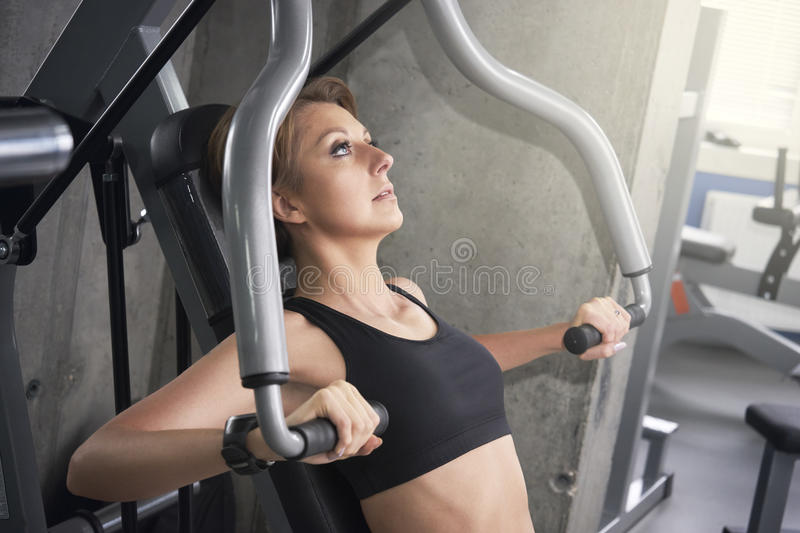 Woman trains pectoral muscles. The Woman trains pectoral muscles stock photos