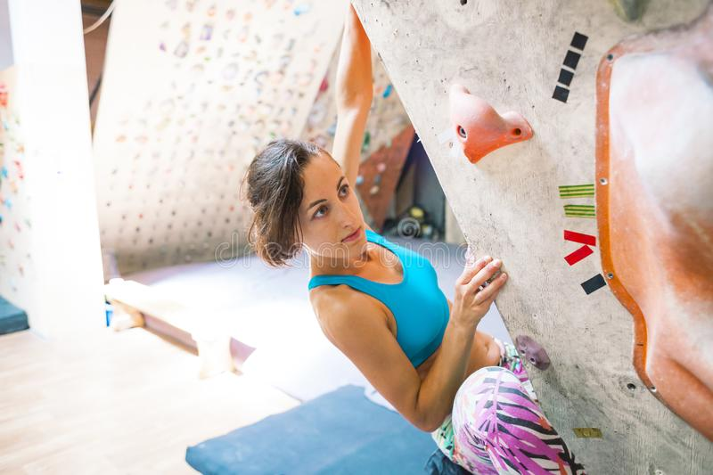 A woman trains to climb. stock images
