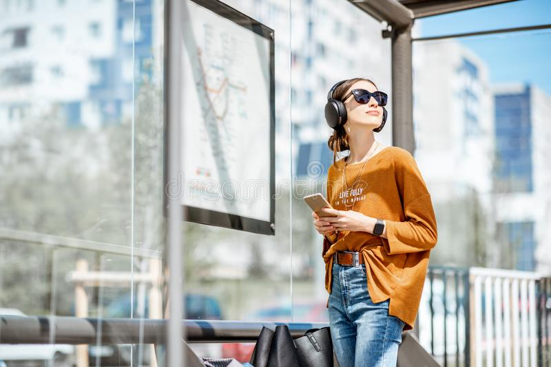 Woman at the tram station in the city stock photos