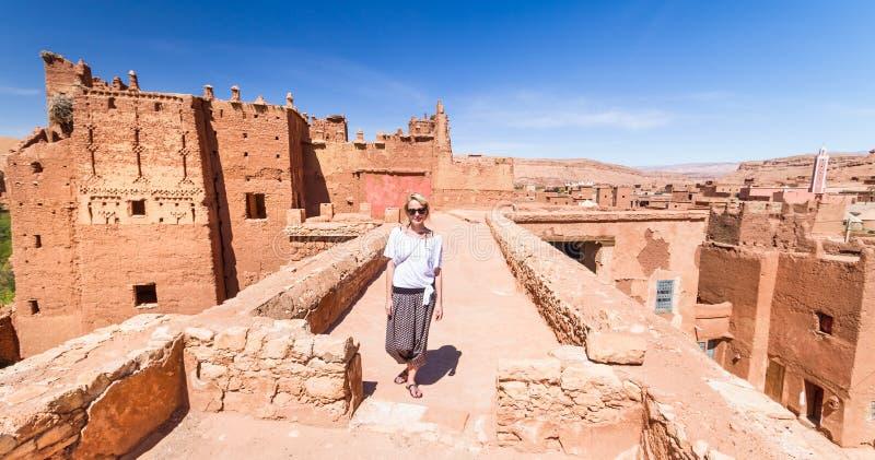 Woman on travel at Ait Benhaddou kasbah, Ouarzazate, Morocco. stock photography