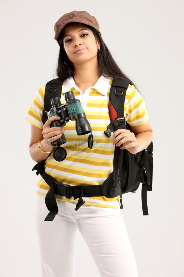 Woman with travel bag and binocular. In white background stock photography