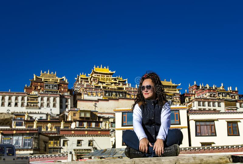 Woman travel photographer on background Songzanlin Monastery royalty free stock photos