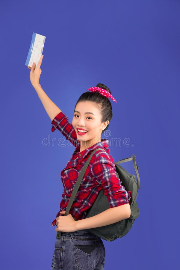Woman travel. Young beautiful asian woman traveler with air tick. Et on blue background stock photos