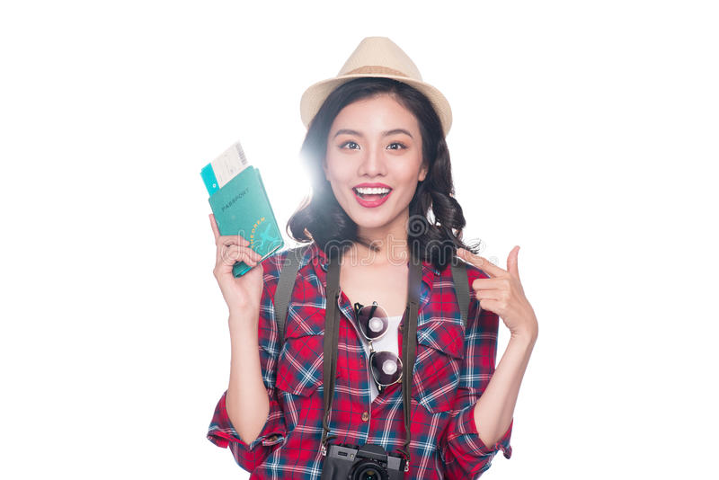 Woman travel. Young beautiful asian woman traveler holding passport and air ticket standing over white. royalty free stock photography