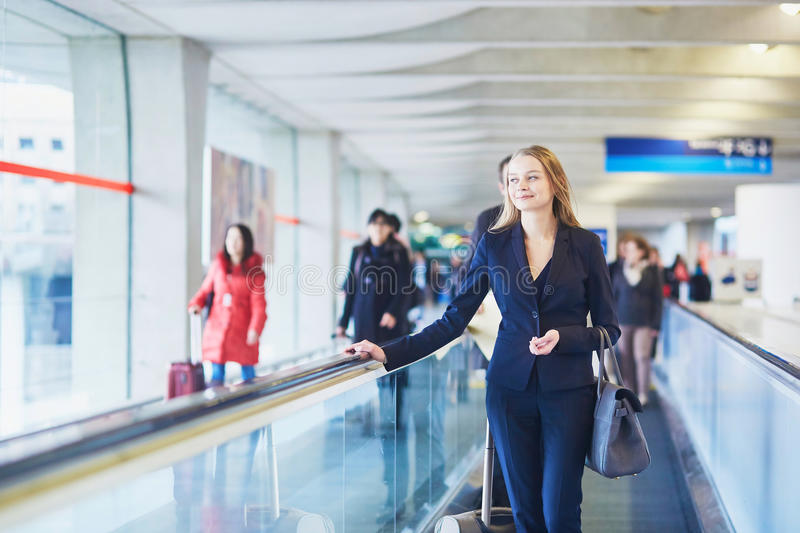 Download Woman On Travelator In The International Airport Stock Photo - Image: 83723144