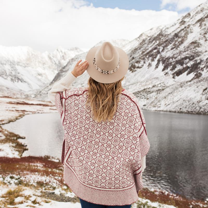 Woman traveler on the background of a mountain lake stock image