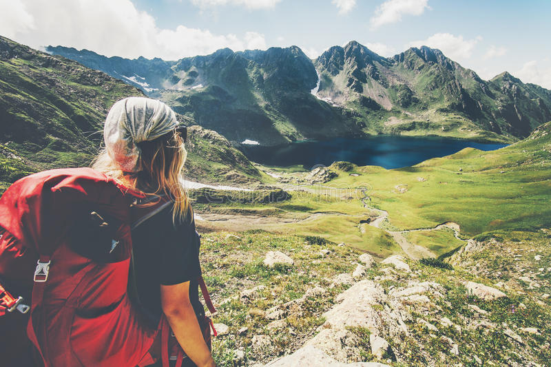 Woman Traveler with backpack hiking stock image
