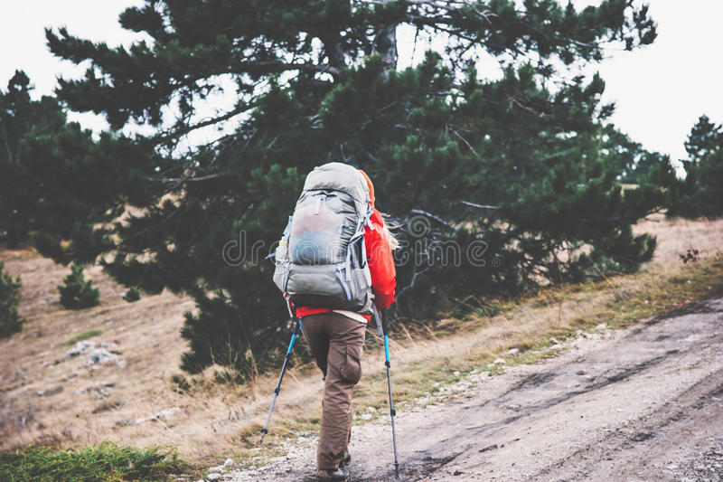 Woman Traveler with big backpack hiking. In wild forest Travel Lifestyle concept adventure active vacations outdoor royalty free stock photo