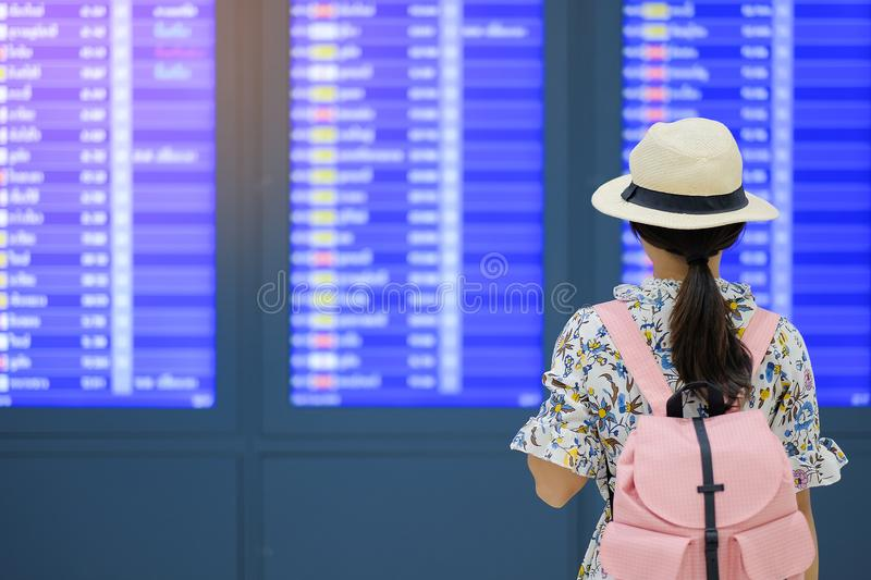 Woman traveler with hat checking flight time stock image