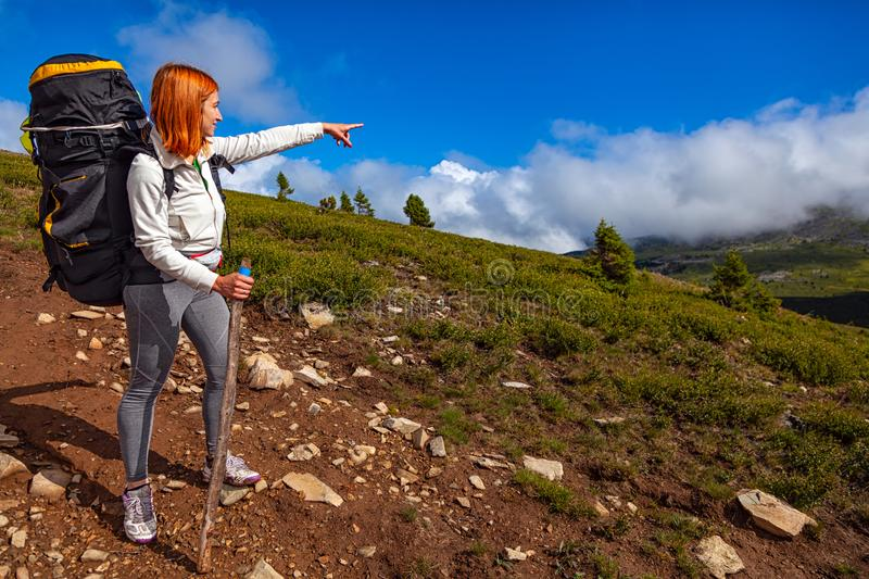 Woman traveler and hiking royalty free stock photography