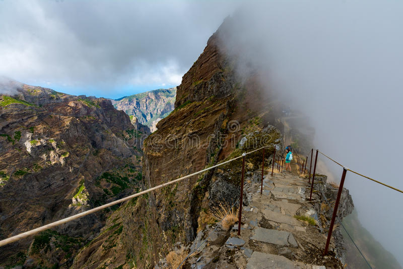 Woman traveler at Madeira mountain hiking path. stock photography