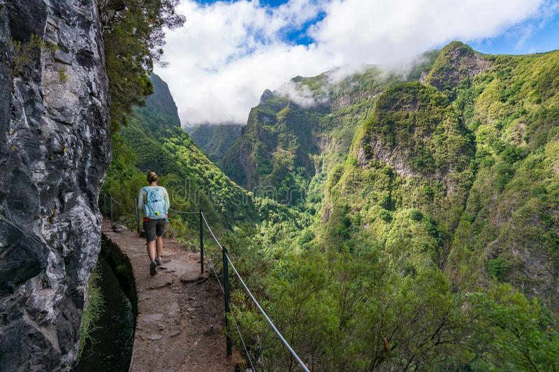 Woman traveler at Madeira mountain hiking path. stock images