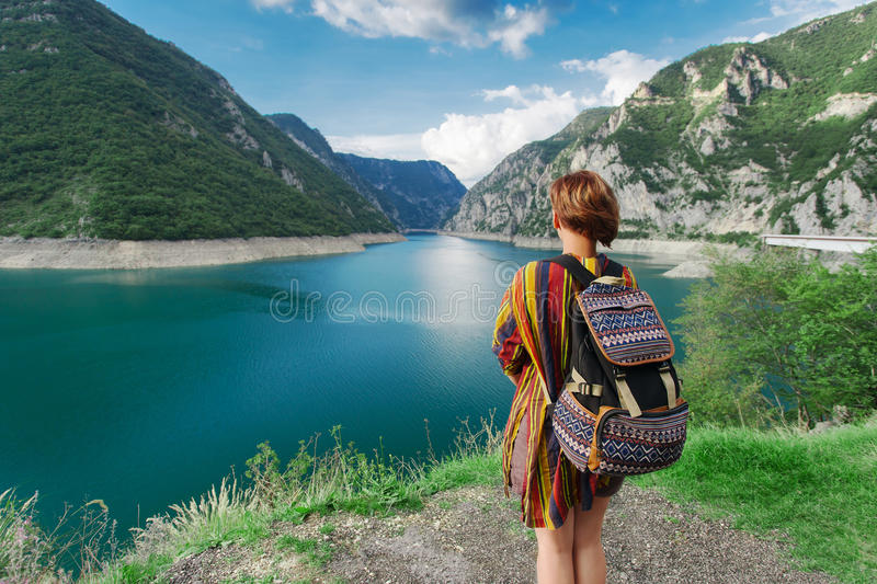Woman traveler near mountains and river royalty free stock photo