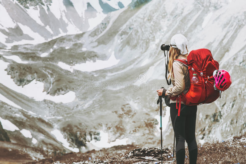 Woman traveler with photo camera hiking stock photos