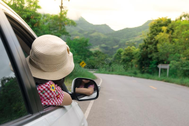 Woman traveler sitting in car royalty free stock photo
