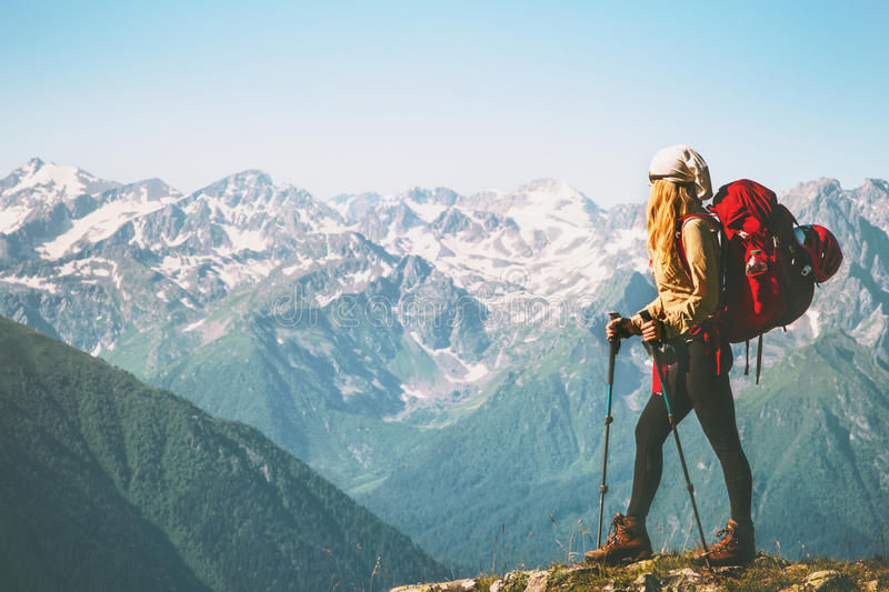 Woman Traveler standing on mountain cliff. With red backpack Travel Lifestyle concept adventure summer vacations outdoor wild nature landscape royalty free stock images