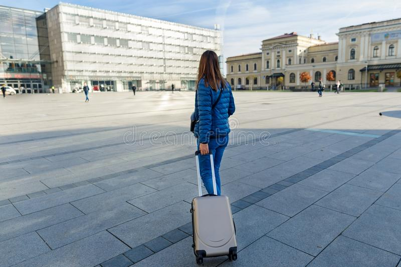 Woman traveler with suitcase at the railway station in Krakow royalty free stock images