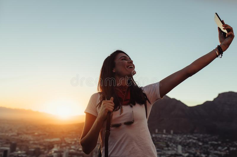 Solo traveler talking selfie outdoors stock photo