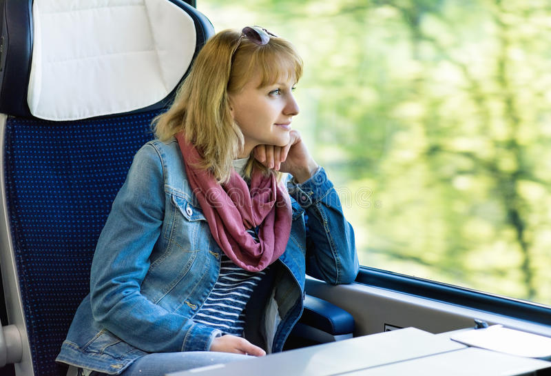 Woman traveler in train stock images