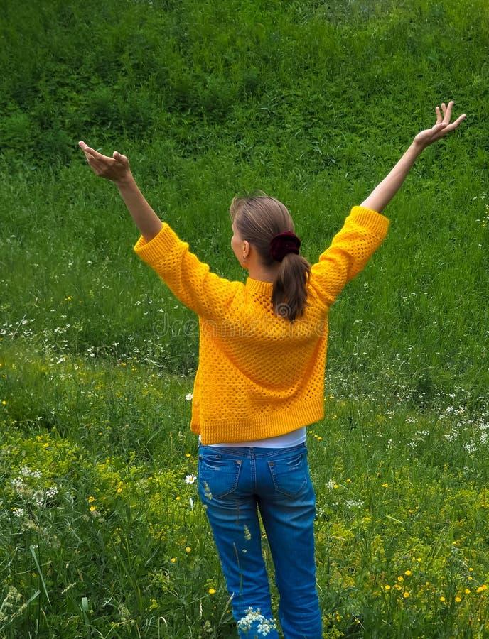 Woman traveler on a walk among the green grass. stock image