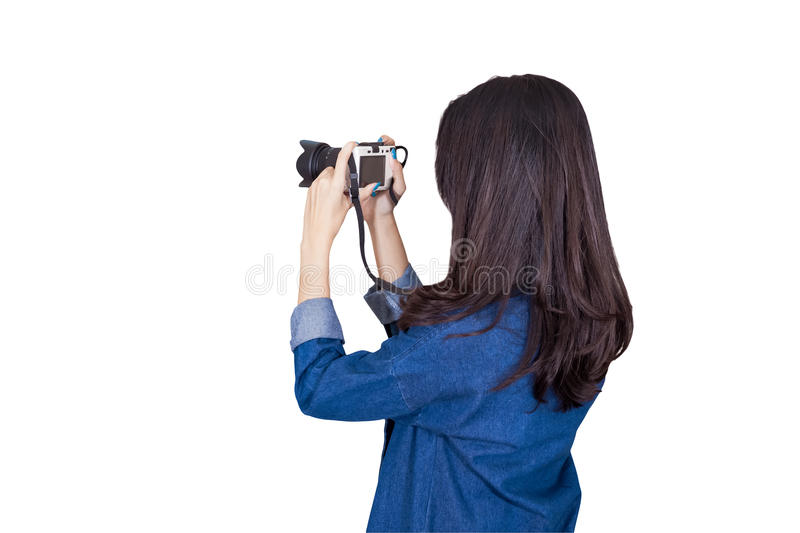 Woman traveler wearing blue dress as photographer, take photo wi. Th camera outdoor, on white background royalty free stock photography