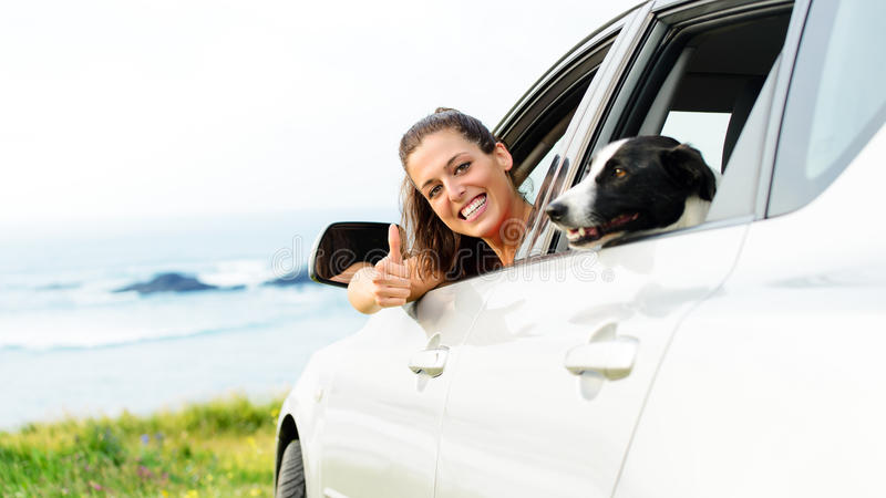 Woman traveling with dog pet stock images