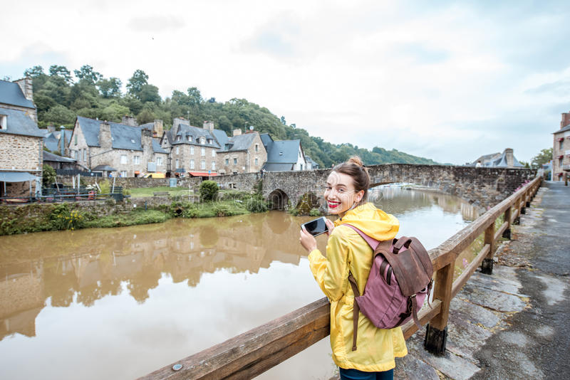 Woman traveling in french town Dinan stock images