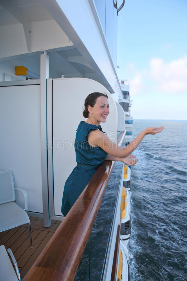 Woman traveling on ship and draws handrail stock images