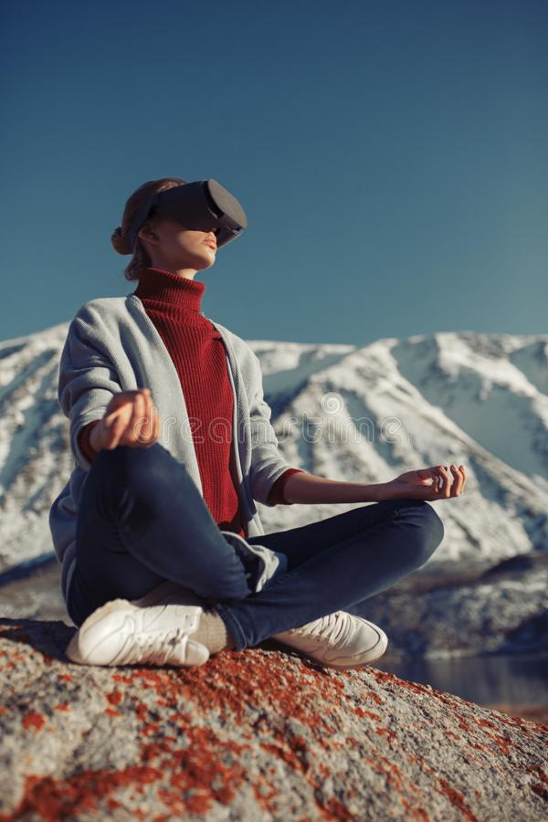 Woman travels in virtual reality. Wild nature stock image