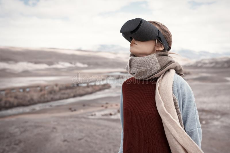 Woman travels in virtual reality. Wild nature stock photography