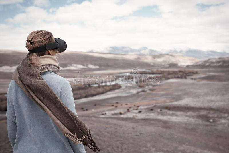 Woman travels in virtual reality. Wild nature stock photos