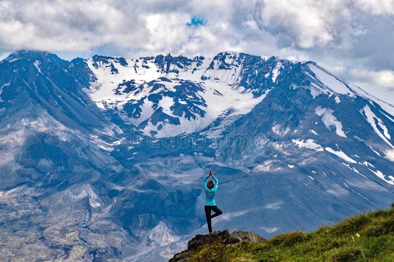 Meditation in nature by mountain. royalty free stock images