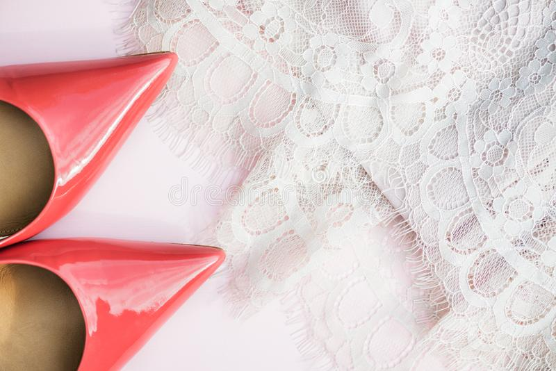 Pink Court Shoes and Lace Dress on Pink Background. Woman Trendy Fashion Accessories such as Pink Court Shoes and Lace Dress on Pink Background, Top View stock images