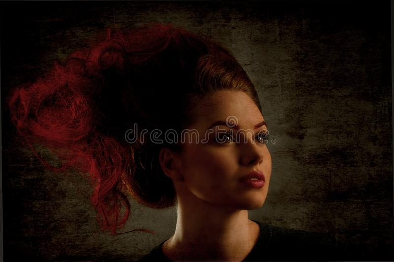 Woman with trendy hairstyle. Young fashion model posing with luxury trendy hairstyle royalty free stock photography