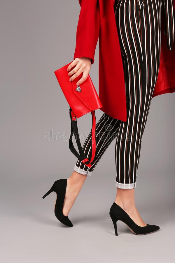 Woman in trendy shoes with bum bag royalty free stock photography