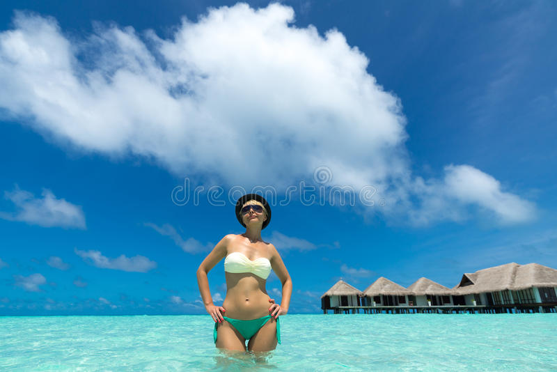 Woman at the tropical beach stock image