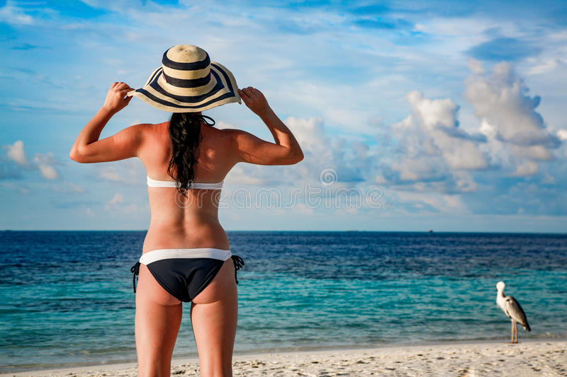 Woman and tropical beach in the Maldives. Beach vacation.Woman and tropical beach in the Maldives stock image