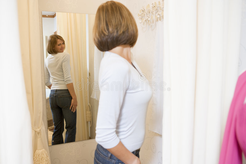 Download Woman Trying On Jeans And Frowning Stock Photo - Image: 5941436