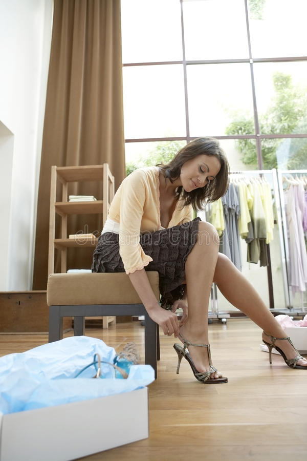 Woman Trying Shoes On Stock Images