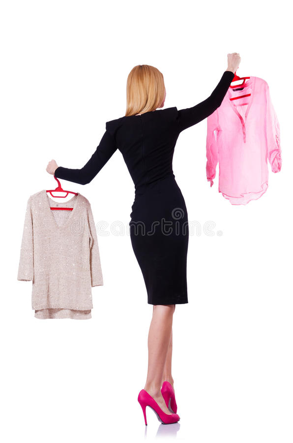 Woman Trying To Choose Dress Royalty Free Stock Image