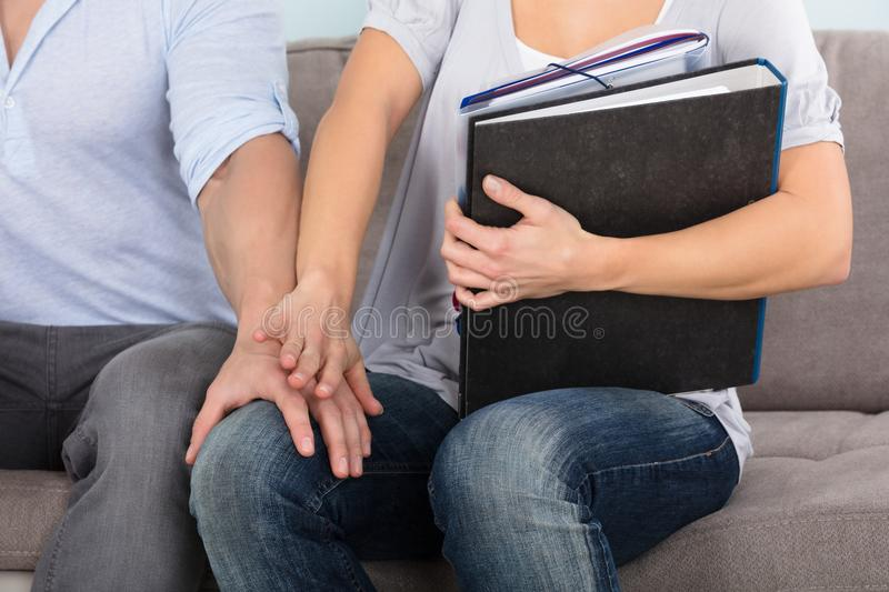 Man Touching Woman`s Knee. Woman Trying To Remove The Man`s Hand Touching Woman`s Knee stock photos