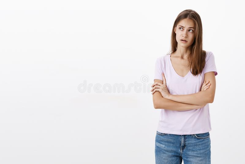 Woman trying understand what boyfriend meant. Focused clueless, confused attractive stylish young woman holding hands stock photo