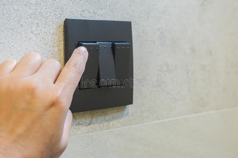 Woman turn off light switch for energy savings. Close up woman turn off light switch for energy savings royalty free stock photos