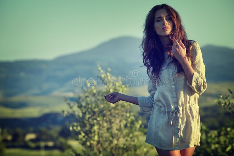 Woman in Tuscany garden stock photos
